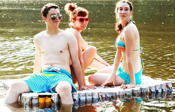 """The cast of """"Beer Can Raft"""" adrift on the White River."""